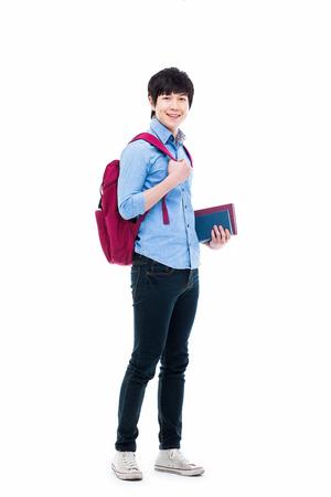 Jonge Aziatische student geïsoleerd op wit Stockfoto - 25161794