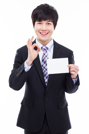 Asian young business man with blank card isolated on white background. photo