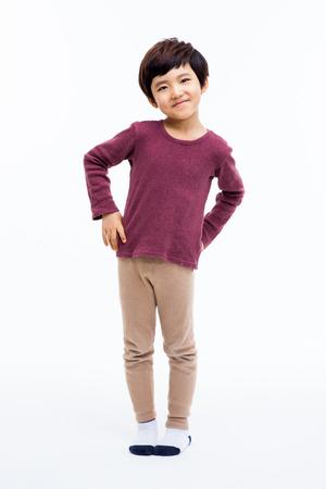 若い幸せのアジアの少年は白い背景に分離されました。 写真素材