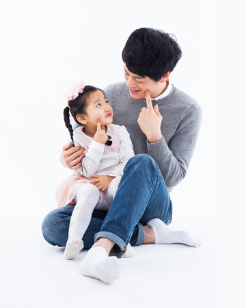 Happy Asian father and daugther isolated on white background.  Stock Photo