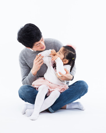 daugther: Happy Asian father and daugther isolated on white background.  Stock Photo