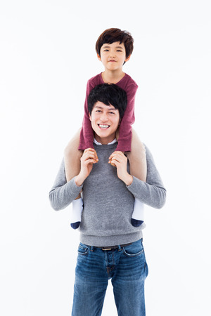 Happy Asian father and son isolated on white background.  Stock Photo