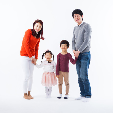 Asian happy family isolated on white background.  Stock Photo