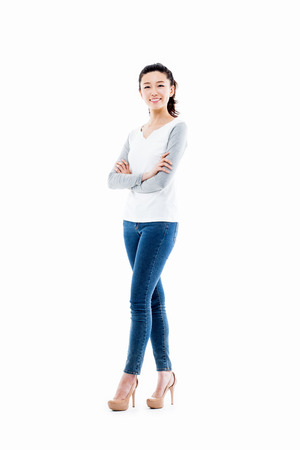 full shot: Young Asian woman full shot isolated on white background. Stock Photo
