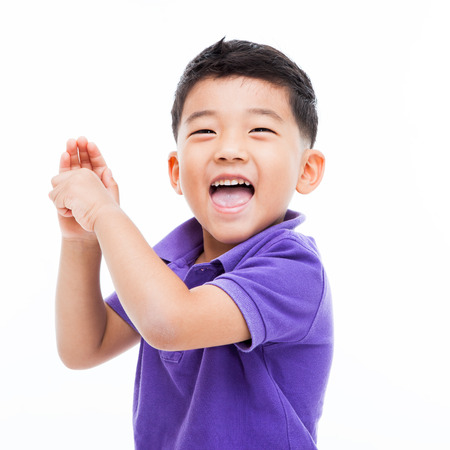 Happy Asian boy isolated on white background.