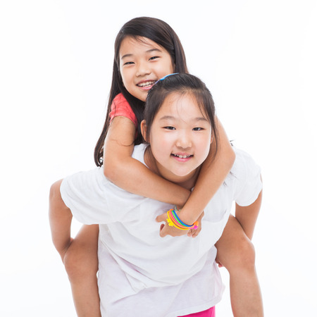 Asian two girls carry on isolated on white. photo