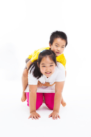 piggyback ride: Happy Asian kids isolated on white.