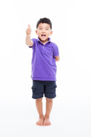 Asian boy shwoing thumb isolated on white background.