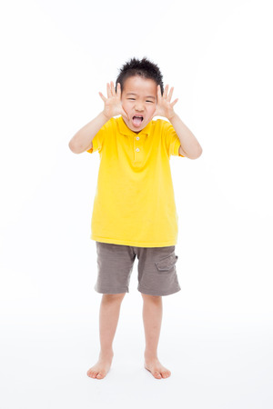 naughty child: Funny young Asian boy full isolated on white background.