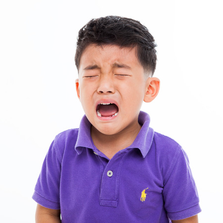 asian toddler: Crying Asian boy isolated on white