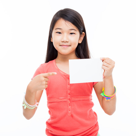 preety: Asian preety girl shwoing empty card isolated on white.