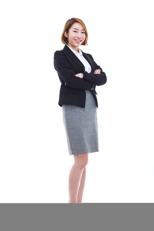 Yong pretty Asian business woman isolated on white background. photo