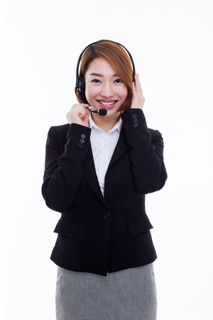 Smiling call center operator business woman isolated on white background. photo