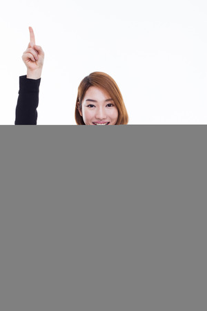 Young business woman point up side isolated on white background. photo