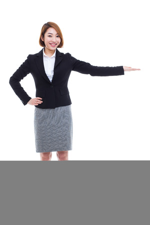Asian business woman indicate blank space isolated on white background. photo