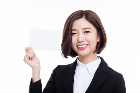 Business woman showing blank card. isolated over white Фото со стока