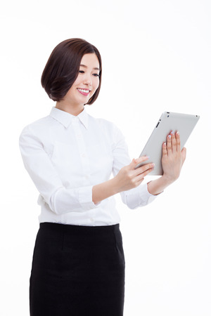 Asian Business woman using pad PC isolated on white background.
