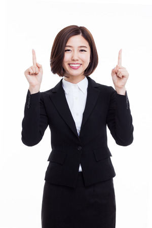 Young business woman point up side isolated on white background. Stockfoto