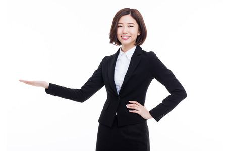 Asian business woman indicate blank space isolated on white background.