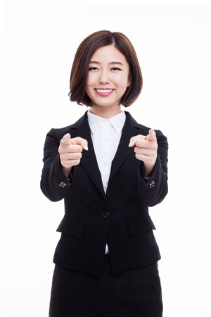 Successful happy Asian businesswoman showing thumb isolated on white background. Фото со стока