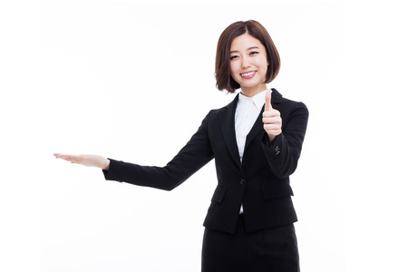 white suit: Asian business woman indicate blank space isolated on white background.
