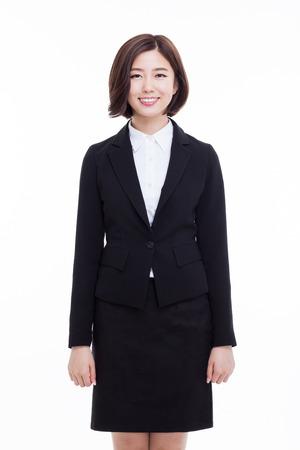 Yong mooie Aziatische zakelijke vrouw geïsoleerd op een witte achtergrond. Stockfoto