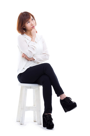 women sitting: Young Asian woman full shot isolated on white background. Stock Photo
