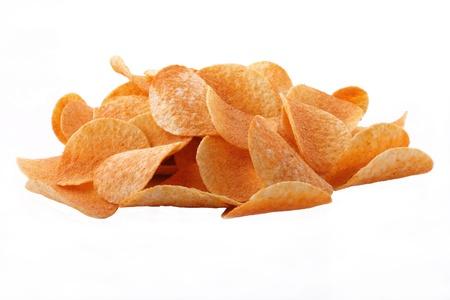 incommunicado: Potato crisps strewn with ground paprika and the pepper incommunicado on the white background