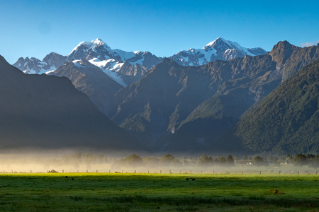 View of Aoraki (Mount Cook) and Mount Tasman frome Lake Matheson, West Coast of South Island of New Zealand.It is famous for its reflected views of AorakiMount Cook and Mount Tasman. Stock Photo