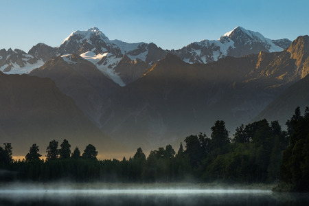 Lake Matheson. Locate near the Fox Glacier in West Coast of South Island of New Zealand.It is famous for its reflected views of AorakiMount Cook and Mount Tasman. Stock Photo