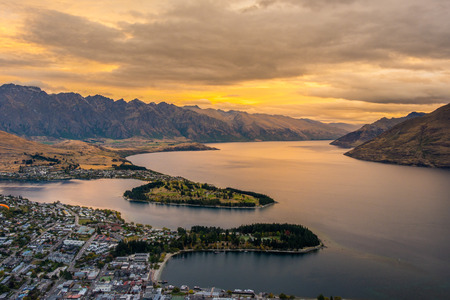 Cityscape of Queenstown and Lake Wakaitipu with The Remarkables in the background from viewpoint at Queenstown Skyline, New Zealand