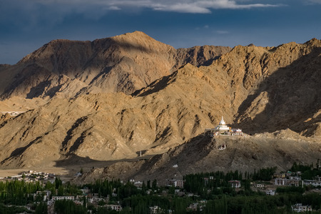 View of Shanti Stupa on a hilltop in Chanspa from Leh Palace in Leh district, Ladakh