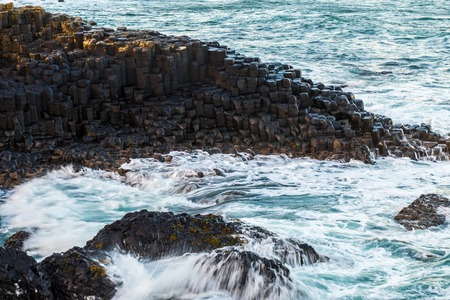 Landscape around Giant`s Causeway, which has numbers of interlocking basalt columns result of an ancient volcanic fissure eruption.It is located in County Antrim on the north coast of Northern Ireland
