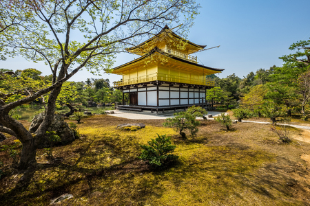 Kinkakuji (Golden Pavilion) is a Zen temple in northern Kyoto, Japan. It top two floors are completely covered in gold leaf. Formally known as Rokuonji Editorial