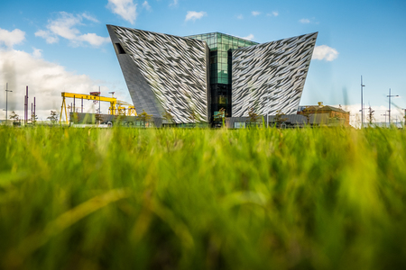 Titanic Belfast is a visitor attraction and a monument to Belfasts marine industrial history on the site of the former shipyard of Harland & Wolff where the RMS Titanic was built, Belfast, Northern Ireland