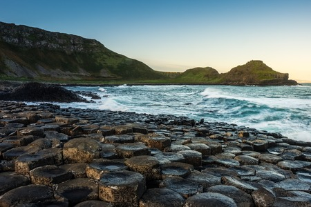 Landscape around Giant`s Causeway, which has numbers of interlocking basalt columns result of an ancient volcanic fissure eruption.It is located in County Antrim on the north coast of Northern Ireland, United Kingdom.