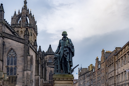 Adam Smith Statue in front of St Giles Cathedral in Edinburgh, United kingdom.