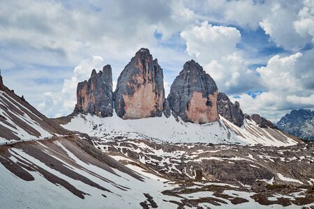 The landscape around Tre Cime di Lavaredo, one of the best-known mountain in the Alps located in Dolomites, Italy Фото со стока