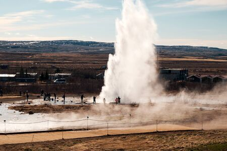 The erupting Stokkur geyser on a sunny day, Located in the Golden Circle route, Iceland