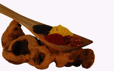 wooden spatula and spices on driftwood Imagens - 4143481