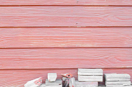 horizontal wooden texture red color and broken gray brick photo