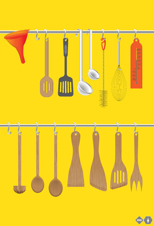 chromed: A collection of wooden kitchen utensils hanging on the chromed bar.