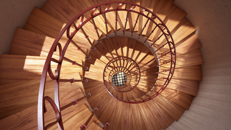 Wooden spiral stairs with rails in sun light interior