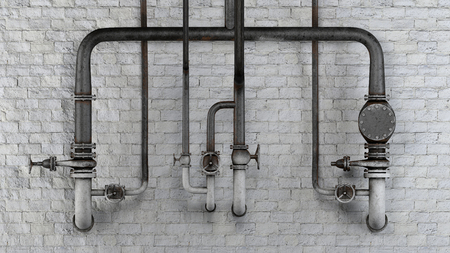 Set of old, rusty pipes and valves against white classic brick wall Standard-Bild