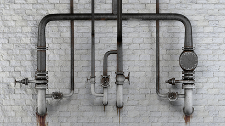 Set of old, rusty pipes and valves against white classic brick wall with leaking stains Stock Photo