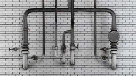 Set of old, rusty pipes and valves against white modern brick wall Archivio Fotografico