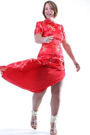 twirling: Girl twirling red dress