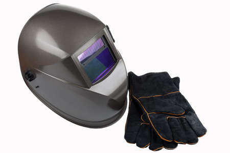 safety gloves: Welding helmet and safety gloves Stock Photo