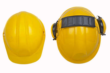 ppe: isolated image of two workmens hardhats - one new the other used Stock Photo
