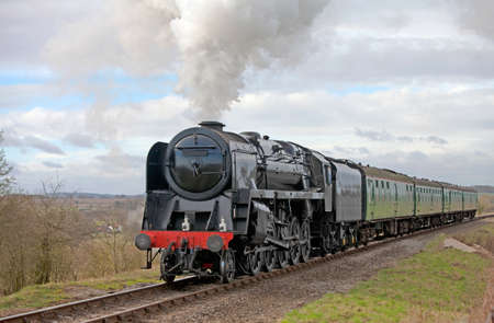 Large passenger steam train out on a day trip excursion photo